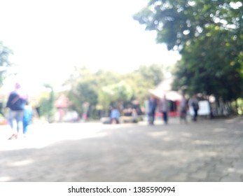 Blurred background of people in park.   Blur people in noon festival city in garden.  Blurred background of people enjoying in holiday.