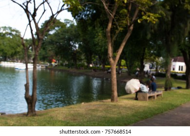 Blurred background of people in park, spring and summer season
