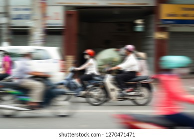 Blurred background of people riding motorbikes in Asia