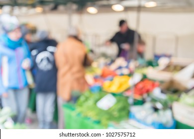 Blurred background of people shopping at market stall