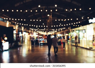 Blurred background : people shopping at market fair, blur background with bokeh.