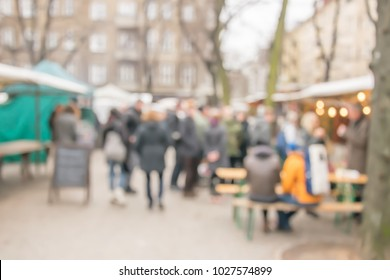 Blurred background of people shopping at street market