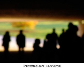 Blurred background, people silhouettes waiting the train at the underground station