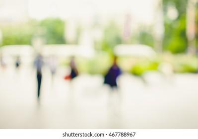 Blurred background : People walking in the street , Vintage Tone