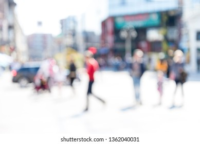 Blurred background. Blurred people walking through a city street.