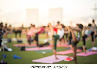 Blurred background of peoples playing yoga outdoor with vintage color tone tuned