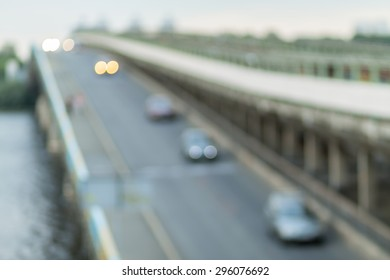Blurred background photo.Cityscape bokeh. Defocused abstract city.Background out of focus.Can use as wallpaper, design. Summer blurry city backdrop.Fairy defocused photos.