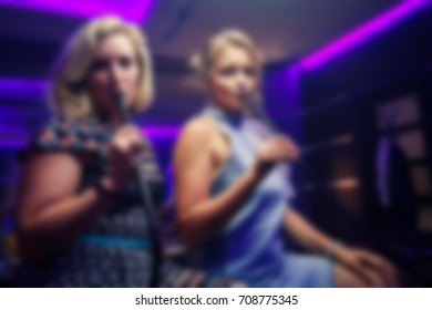 Blurred background photography of people in a nightclub