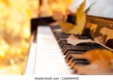 Blurred background. The piano is autumn. Leaf fall in the forest. Abstraction
