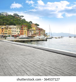 blurred background of Portofino port and old gray street