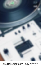 Blurred background with professional party dj audio equipment for hip hop concert and sound recording studio.Out of focus disc jockey music equipment back ground.Party poster with hifi stereo setup