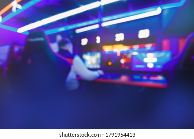Blurred background professional team gamer stream playing tournaments online games computer with headphones, red and blue.