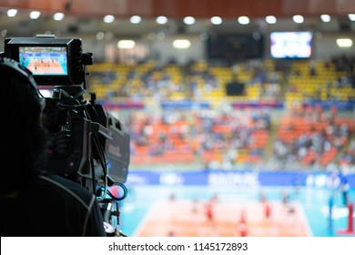 Blurred background of professional volleyball league cup championship international competition live sport news tv show from indoor arena with fans crowd cheer up and watching from stand for victory