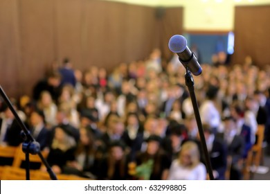 Blurred background of public event exhibition hall show concept with microphone