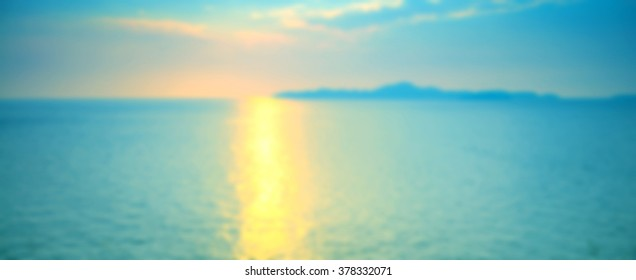 Blurred background of refraction in water. Panoramic dramatic view of Infinity sunset on the sea at twilight times.