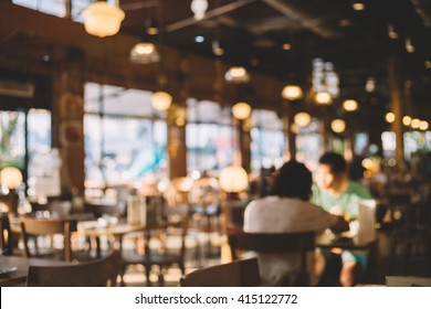 Blurred background of restaurant with people.