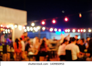 Blurred background in the rooftop restaurant at night