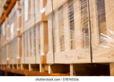 Blurred background of rows of shelves and racks with boxes goods in factory warehouse, copy space.