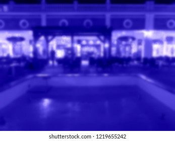 blurred background of scene in a restaurant, blurred unrecognizable people sitting at the table in the garden. Blur caffe and peopple background. Caffe, restaurant outside