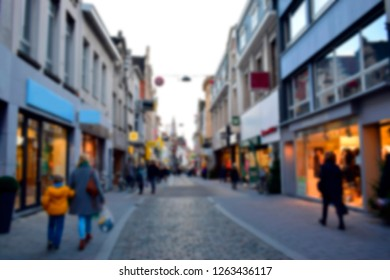 Blurred for background of shops and restaurands with people walking on sidewalk in city center, this place is one of famous fashionable area in Lier, Antwerp, Belgium. Travel and lifestyle concept.