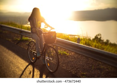 Blurred background of silhouette women riding bicycle