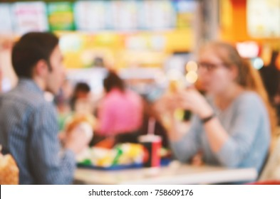 Blurred background. Blurred silhouettes of sitting people in coffee