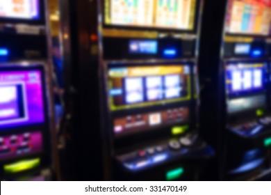 blurred background of slot machines in casino