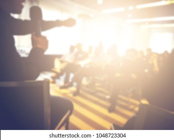 Blurred background of smart handsome good looking men giving happy and fun professional business speech in conference. Use in workshop, training lecture, seminar event