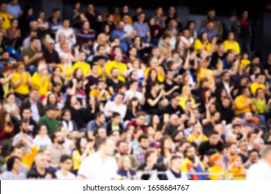 blurred background of sport fans during a game