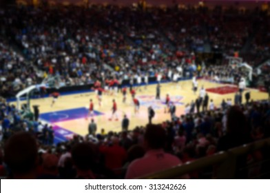 blurred background of sports arena crowd