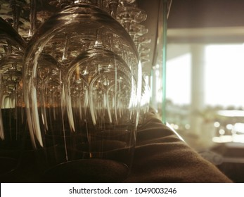 Blurred background of stack of wine glass on shelf ready to serve
