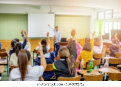 Blurred background of students raise hands in the lecture room, or classroom - educational concept