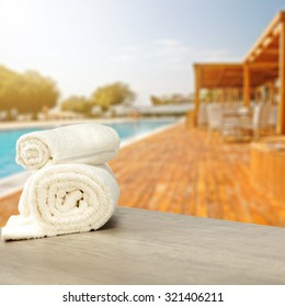 blurred background of summer spa and towels