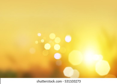Blurred background : sunset landscape with bokeh sun light abstract background. blur concept. Retro color style. mountain background grass, wallpaper design