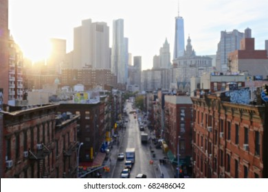Blurred background of sunset over the Lower East Side of Manhattan, New York, NY, USA.