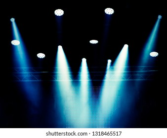 Blurred background, theatrical scene lighting in a haze of blue color during a concert. Banner for design.