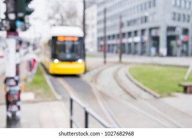 Blurred background of tram arriving at stop