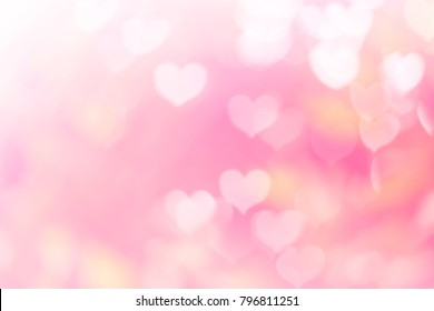 Blurred background of Valentine's day concept. Valentines Day Card. Pastel color tones.multicolored white hearts wallpaper.