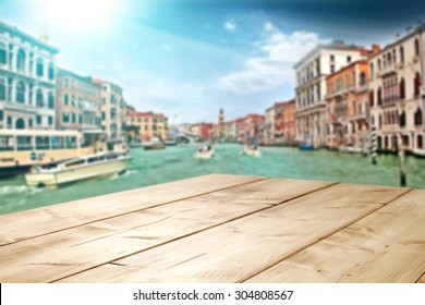 blurred background of Venice city and deck and boats on water