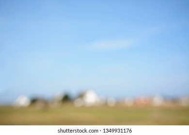 blurred background, village and blue sky