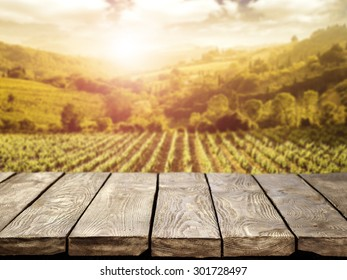 blurred background of vineyard and brown table