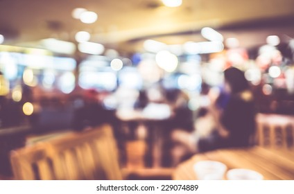 Blurred background : Vintage filter ,People in Coffee shop blur background with bokeh