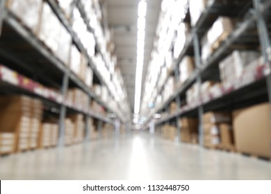 Blurred background of warehouse or storehouse industrial and logistic company.Warehousing on the floor and called the high shelves