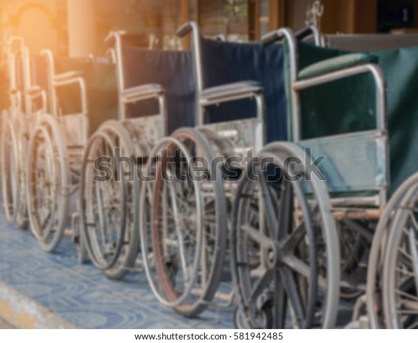 Blurred background Wheelchair for hospital patients. Equipment Facilities.