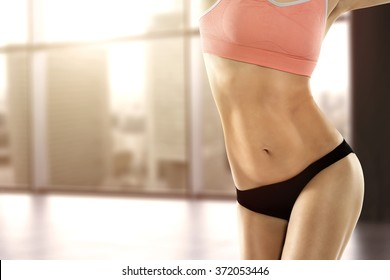 blurred background of window and woman stomach