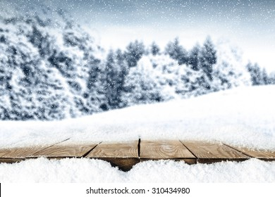 blurred background of winter and winter big table and snow