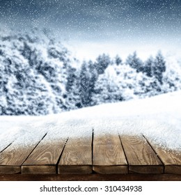 blurred background of winter and board place of wood and space for your decoration and white snow space