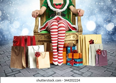 blurred background of winter background with stone floor and elf legs and few bags