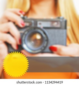 Blurred background of a woman holding a camera with web elements for advertising
