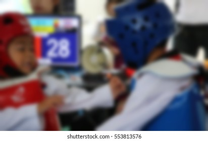 blurred background of Young Taekwondo athletes are fighting during contest